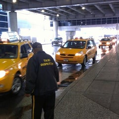 Photo taken at JFK Yellow Cab Queue by Spencer M. on 6/13/2012