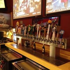 Photo taken at Buffalo Wild Wings Grill & Bar by Derek H. on 2/17/2012