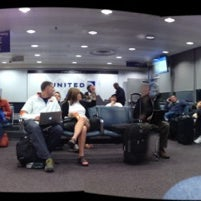 Photo taken at Gate F7A by Chuck B. on 3/26/2012