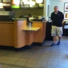 Photo taken at Starbucks by Emily E. on 8/25/2011