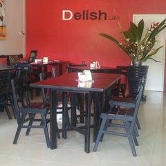 Photo taken at Delish Cafe by Olivier D. on 2/18/2011