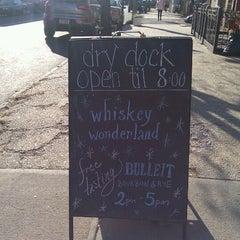 Photo taken at Dry Dock Wine & Spirits by Mina V. on 12/11/2011