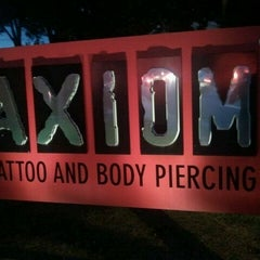 Photo taken at Axiom Tattoo and Piercing by Taco B. on 10/1/2011