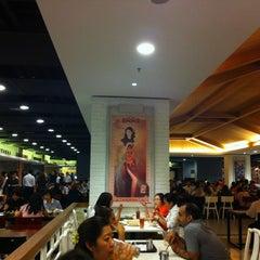 Photo taken at EAT Food Village by Justine M. on 5/3/2012