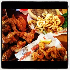 Photo taken at Hooters by Tim B. on 8/30/2012