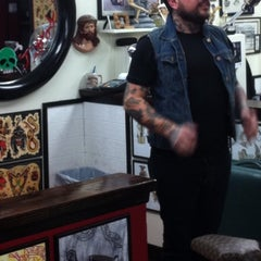 Photo taken at Sid's Tattoo Parlor by Kyle C. on 1/2/2011