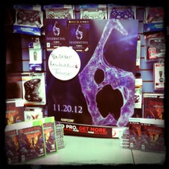 Photo taken at GameStop by Tierra M. on 3/20/2012