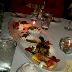 Photo taken at Barcelona Restaurant & Bar by Holly B. on 1/28/2012