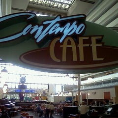 Photo taken at Contempo Cafe by CJ H. on 6/7/2012