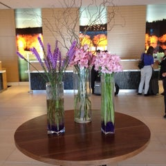 Photo taken at JW Marriott Lobby by Jenny N. on 5/23/2012