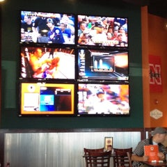 Photo taken at Buffalo Wings & Rings by Justin J. on 6/21/2012