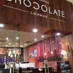 Photo taken at Theobroma Chocolate Lounge by Ryan S. on 9/2/2012