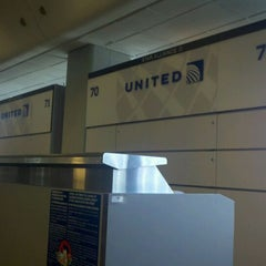 Photo taken at Gate 70 by Lisa A. on 10/2/2011