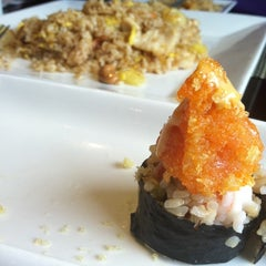 Photo taken at Wild East Pan-Asian Bistro by Hannah B. on 9/7/2011