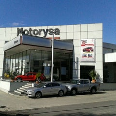 Photo taken at Motorysa Mitsubishi Colombia by Alejandro B. on 12/21/2011