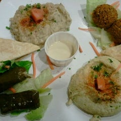 Photo taken at Feast Kitchen & Grill by Katrina G. on 11/3/2011