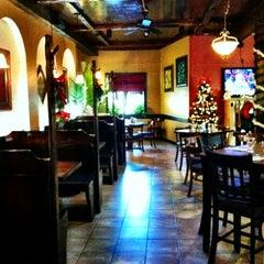 Photo taken at Millonzi's by Cristina P. on 12/9/2011