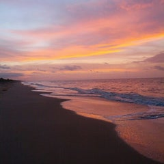 Photo taken at Playa de Boca de Uchire by Zoris V. on 8/19/2012