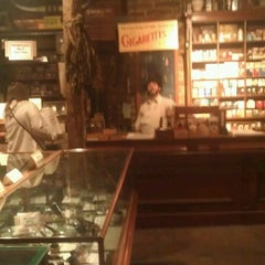 Photo taken at Racine & Larame Cigar Shop by Dominic W. on 1/28/2012
