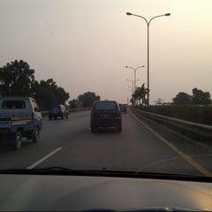 Photo taken at Jalan Tol Lingkar Luar Jakarta Seksi E1 (JORR E1) by Yudha 1. on 7/28/2012