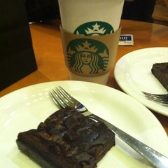 Photo taken at Starbucks by Bruna T. on 5/1/2012