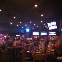 Photo taken at Gator's Dockside by Sarah M. on 3/11/2012