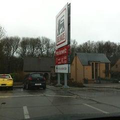 Photo taken at Delhaize by pixl M. on 12/23/2011