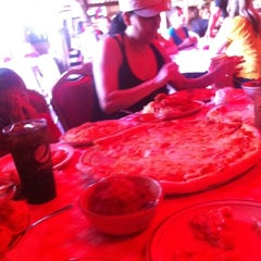 Photo taken at Filippi's Pizza Grotto by Marlen A. on 8/30/2012