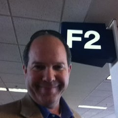 Photo taken at Gate F2 by Christopher A. on 8/17/2012