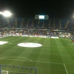 Photo taken at Estadio La Rosaleda by Ruben B. on 2/29/2012