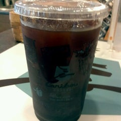 Photo taken at Caribou Coffee by Stylistrashad on 6/7/2012