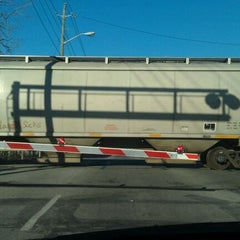 Photo taken at Michigan Street Railroad Crossing by E. H. on 3/10/2012