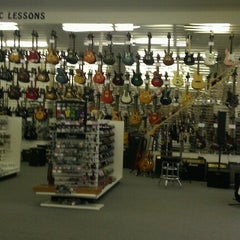 Photo taken at Guitars Etc by Mellissa E. on 8/28/2012