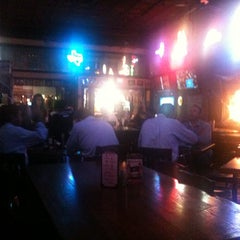Photo taken at Bikinis Sports Bar & Grill by Andrea C. on 10/26/2011