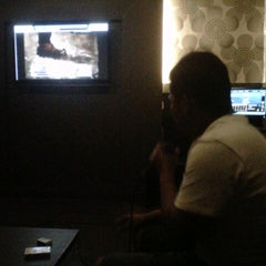 Photo taken at AROSA cafe & family karaoke by dewina a. on 8/11/2012