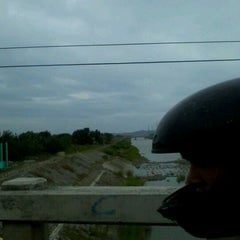 Photo taken at Jaro Floodway by Philip Ceasar H. on 3/17/2012