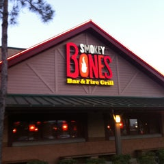 Photo taken at Smokey Bones Bar & Fire Grill by Gerald H. on 5/24/2012