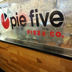 Photo taken at Pie Five Pizza Co. by Latasha G. on 9/10/2012