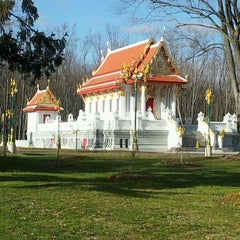 Photo taken at Wat Mongkoltepmunee (Thai Buddhist Temple) by Joey P. on 12/26/2011