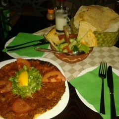 Photo taken at Arabian Taverna by Magdalena J. on 11/30/2011