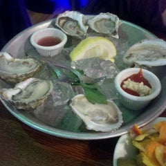 Photo taken at East Coast Grill & Raw Bar by Alicia V. on 5/2/2012
