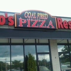 Photo taken at Nino's Coal Fired Pizza by Peter P. on 10/2/2011