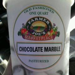 Photo taken at Farmer Joe's Marketplace by Syb K. on 2/4/2012