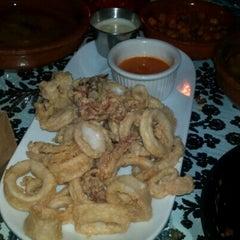 Photo taken at Estragon Tapas Bar by Sarah on 8/21/2012