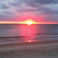 Photo taken at Vanderbilt Beach by Cherie W. on 5/20/2012