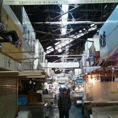 Photo taken at 築地市場 (Tsukiji Fish Market) by Kaz O. on 12/30/2011