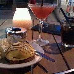 Photo taken at News Café by Dana C. on 8/23/2011