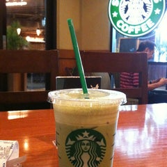 Photo taken at Starbucks by chandra y. on 3/27/2012