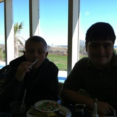 Photo taken at The Carousel Patio Bar & Grill by Crystal G. on 3/10/2012