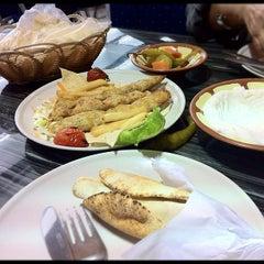 Photo taken at Yahala Restaurant by Kat D. on 3/9/2012